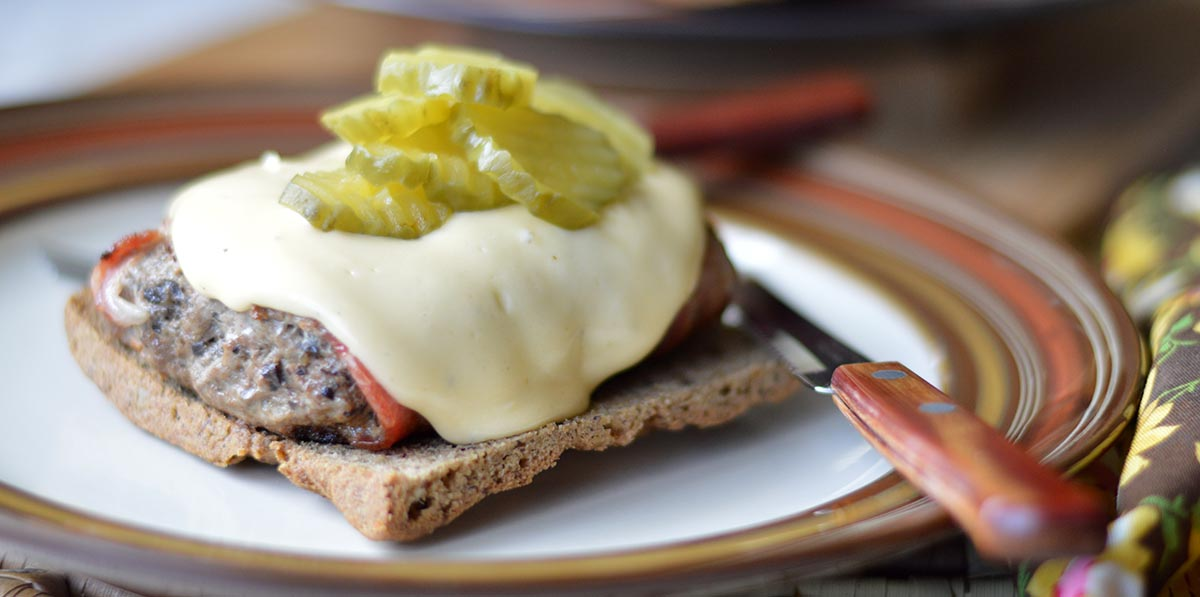 Open-Faced Bacon-Wrapped Meatloaf Sandwich with Cheddar Sauce and Pickles
